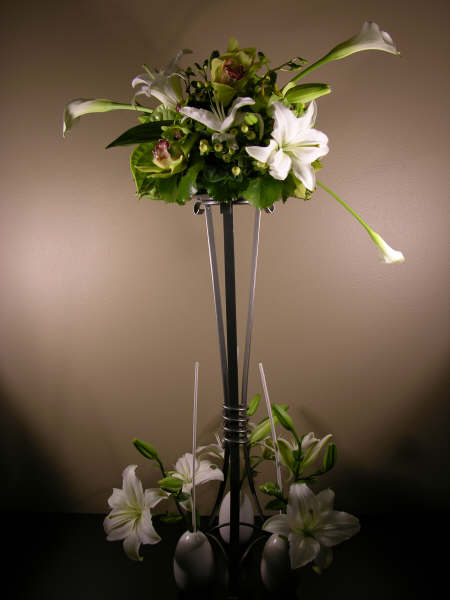 Tall wrought iron stand centerpiece cakes centerpieces