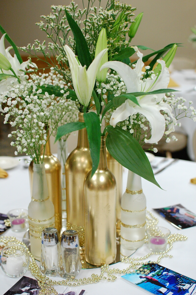 Gold centerpieces wine and beer bottles cakes